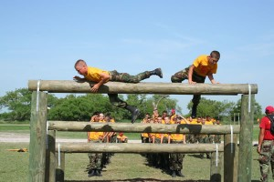 Junior ROTC cadets run the obstacle course