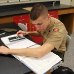 A military school student studying STEM related lessons in physics class.