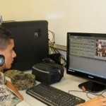 a student edits a video using special software