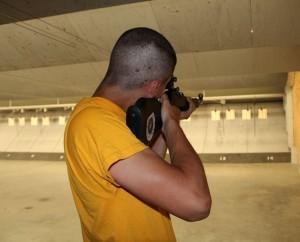 A cadet at the indoor marksmanship center