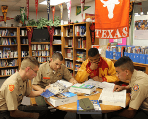 Cadets at the Marine Military Academy look over college research literature in the school's college room.