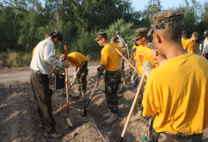 Military school cadet s volunteer for a reforestation project.