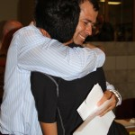 parent hugs son at boarding school registration day