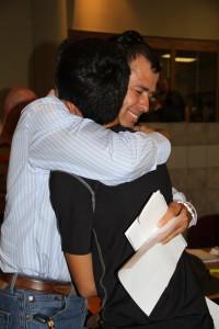 parent hugs son at boarding school registration day