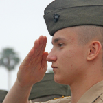 a military school cadet saluting