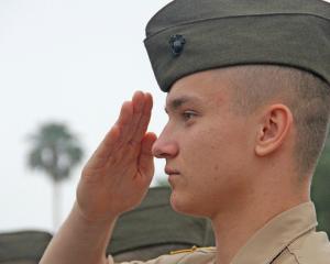 a military school cadet saluting