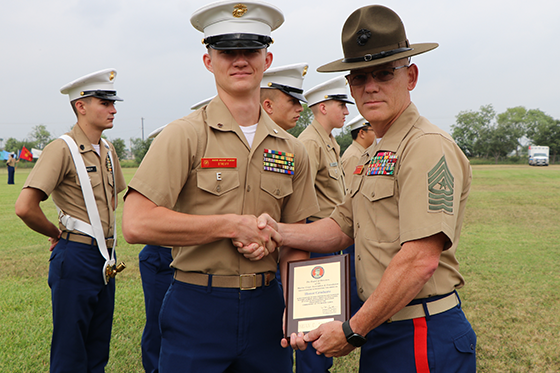Cadet receiving an end of year award